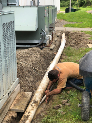 worker-cleaning-pipes